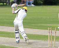 Ted Greally of North London is bowled by Will Brookes during the Middlesex County Cricket League Division Three game between Highgate and North London at Park Road, Crouch End on Sat July 12, 2014