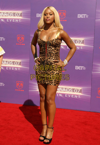 EVE.2007 BET Awards held the at Shrine Auditorium, Los Angeles, California, USA..June 26th, 2007.full length hands on hips leopard print bracelets tattoos .CAP/ADM/RE.©Russ Elliot/AdMedia/Capital Pictures