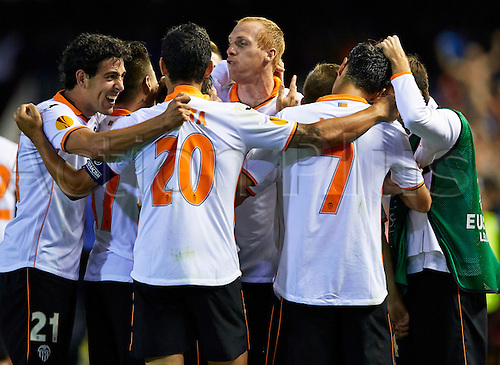 01.05.2014 Valencia, Spain. Defender Jeremy Mathieu of Valencia CF (C) celebrates with his team mates after scoring the third goal for his team during the Europa Leauge Semi Finals between Valencia CF and Sevilla CF  at Mestalla stadium, Valencia