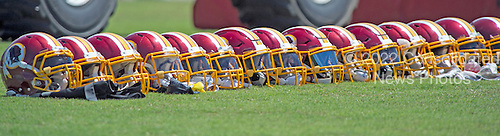 Washington Redskins player's helmets are lined-up on the sidelines as their owners participate in drills during the Veteran Minicamp at Redskins Park in Ashburn, Virginia on Tuesday, June 14, 2016.<br /> Credit: Ron Sachs / CNP