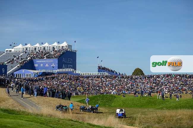 A wide view of the massive crowd gathered near the green on 9 during Saturday's foursomes of the 2018 Ryder Cup, Le Golf National, Guyancourt, France. 9/29/2018.<br /> Picture: Golffile   Ken Murray<br /> <br /> <br /> All photo usage must carry mandatory copyright credit (© Golffile   Ken Murray)