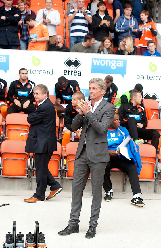 Blackpool manager Jos&eacute; Riga applauds the fans as he takes his place in the dug-out just before the kick-off<br /> <br /> Photographer Stephen White/CameraSport<br /> <br /> Football - The Football League Sky Bet Championship - Blackpool v Wolverhampton Wanderers - Saturday 13th September 2014 - Bloomfield Road - Blackpool<br /> <br /> &copy; CameraSport - 43 Linden Ave. Countesthorpe. Leicester. England. LE8 5PG - Tel: +44 (0) 116 277 4147 - admin@camerasport.com - www.camerasport.com