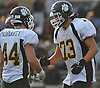 Sam Godelski #73, right, and Christian Moriarty #44 celebrate after their team's playoff berth-clinching 26-14 win over host Whitman High School in a Suffolk County Division I varsity football game on Saturday, Oct. 29, 2016.