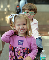 Maeve Burton, 2and her brother Seamus, 4, wear Heather stickers at a memorial for Heather Heyer Wed., August 16, 2017, at the Paramount Theater in Charlottesville, Va. Heyer was killed the previous weekend when a vehicle drove into a crowd of counter-protestors after the Unite The Right rally. Photo/Andrew Shurtleff