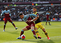 29th February 2020; London Stadium, London, England; English Premier League Football, West Ham United versus Southampton; Aaron Cresswell of West Ham United intercepts Shane Long of Southampton