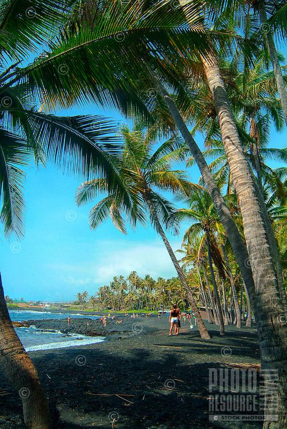 People relax at Punalu'u Beach (or Black Sand Beach), Big Island of Hawai'i.