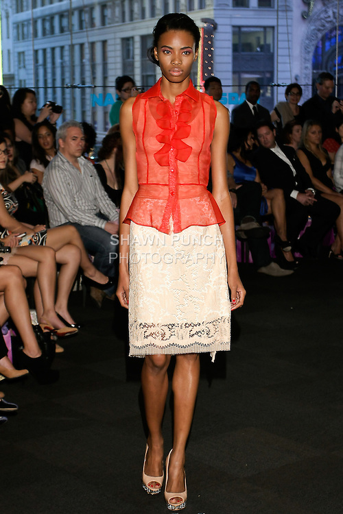"""Model walks runway in a red ruffle sleeveless blouse with French beige lace skirt, from the Yuna Yang Spring Summer 2013 """"Close your eyes and see the world"""" collection, at the NASDAQ Marketsite, during New York Fashion Week, on September 7, 2012."""