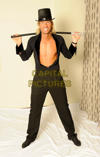 Robbie Savage .studio session, London, England 29th September 2011.**EXCLUSIVE ALL-ROUNDER**.full length topless chest black top hat shirt trousers cane   .CAP/FIN.©Steve Finn/Capital Pictures........THIS IS A SPEC PICTURE>FEE REQUIRED FOR USEAGE.CAP/FIN.©Steve Finn/Capital Pictures.