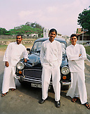 SRI LANKA, Asia, Galle, portrait of Bell Hop and Concierge of the Amangalla Hotel standing in front of Vintage car