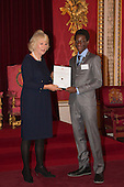 London, Uk. 15/10/2015. HRH The Duchess of Cornwall with Tawanda Mulalu, 18, Senior Runner-up, from Maru-a-Pula School in Botswana. The Duchess of Cornwall on behalf of Her Majesty The Queen, Patron of The Royal Commonwealth Society, holds a reception for winners of The Queen's Commonwealth Essay Competition at Buckingham Palace. The Queen's Commonwealth Essay Competition was founded in 1883 and is the world's oldest international schools' writing contest. This year's competition, sponsored by Cambridge University Press, received more than 13,000 entries from over 600 schools in 49 Commonwealth countries and territories. The Duchess of Cornwall hands out awards to young writers who have travelled from across the Commonwealth to attend the reception. This year's winners have come from Cyprus, Botswana, The Cayman Islands and as far away as Tristan da Cunha - over 9000km away.
