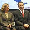 Nassau County Executive Laura Curran glance at New York State Governor Andrew Cuomo as he smiles during a news conference at Nassau Coliseum on Monday, Jan. 29, 2018. Cuomo announced the site will host a portion of Islanders home games over the next three seasons as the team's new arena at Belmont is being constructed.