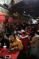 CHINA. Hubei Province. Wuhan. People eating in a semi-oudoor restaurant. Wuhan (population 4.3 million) is a sprawling city that sits on both sides of the Yangtze River.  2008.
