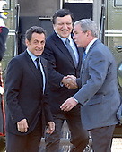 Camp David, MD - October 18, 2008 --  United States President George W. Bush, right, welcomes President Nicolas Sarkozy of France, who also serves as this year's rotating President of the European Union (EU), left, and President José Manuel Barroso of the European Commission (EC), center,  to the Presidential Retreat near Thurmont, Maryland for talks on Saturday, October 18, 2008.  The two European leaders stopped at Camp David to meet with President Bush to discuss the economy on their way home from a summit in Canada to try to convince Bush to support a summit by year's end to try to reform the world financial system..Credit: Ron Sachs / Pool via CNP