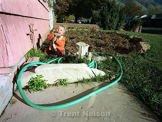 Noah Nelson chewing on a hose.<br />