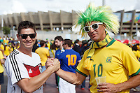 A Brazil fan and a German fan