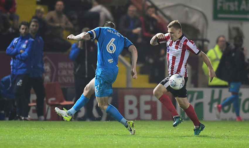 Lincoln City's Harry Anderson vies for possession with Barnet's Michael Nelson<br /> <br /> Photographer Andrew Vaughan/CameraSport<br /> <br /> The EFL Sky Bet League Two - Tuesday 26th September 2017 - Lincoln City v Barnet - Sincil Bank - Lincoln<br /> <br /> World Copyright &copy; 2017 CameraSport. All rights reserved. 43 Linden Ave. Countesthorpe. Leicester. England. LE8 5PG - Tel: +44 (0) 116 277 4147 - admin@camerasport.com - www.camerasport.com