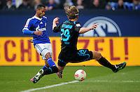 FUSSBALL   1. BUNDESLIGA   SAISON 2012/2013    27. SPIELTAG FC Schalke 04 - TSG 1899 Hoffenheim                       30.03.2013 Raffael (li, FC Schalke 04) erzielt das Tor zum 2:0. Jannik Vestergaard (re, TSG 1899 Hoffenheim) kommt zu spaet
