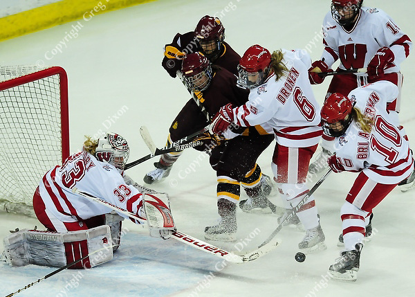 Badgers' goaltender Alex Rigsby, defender Anne Dronen (6), and forward Brittany Ammerman (10) fight for the puck, as Wisconsin women's hockey team tops Minnesota-Duluth 2-1 to advance to the Frozen Four on Saturday, 3/12/11, at the Kohl Center in Madison, Wisconsin