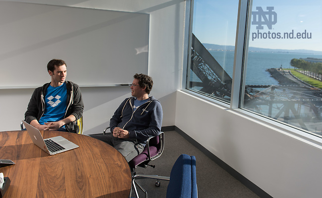 Nov. 17, 2014; Malcolm Phelan '12, and Bill Thanhouser '09 chat in the dropbox.com offices in San Francisco, CA. (Photo by Matt Cashore/University of Notre Dame)