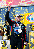 Nov 17, 2019; Pomona, CA, USA; NHRA funny car driver Robert Hight celebrates with the championship trophy after clinching the 2019 funny car world championship during the Auto Club Finals at Auto Club Raceway at Pomona. Mandatory Credit: Mark J. Rebilas-USA TODAY Sports