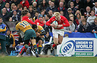 Welsh winger Jimmy Norris flies through the air as he is tackled during the 3rd/4th place clash at Ravenhill, Belfast. Result Australia 25 Wales 21.