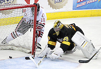 Ryan Walters slips the puck past Colorado College goalie Josh Thorimbert to tie the game at 2-2. Colorado College defeated Nebraska-Omaha 5-2 Saturday night at CenturyLink Center in Omaha. (Photo by Michelle Bishop) .