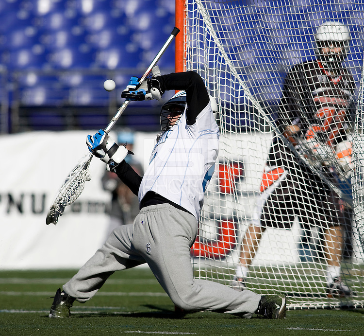 Michael Gvozden (6) of Johns Hopkins makes a save during the Face-Off Classic in at M&T Stadium in Baltimore, MD