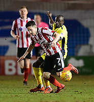 Lincoln City's Tom Pett vies for possession with Cheltenham Town's Sanmi Odelusi<br /> <br /> Photographer Chris Vaughan/CameraSport<br /> <br /> The EFL Sky Bet League Two - Lincoln City v Cheltenham Town - Tuesday 13th February 2018 - Sincil Bank - Lincoln<br /> <br /> World Copyright &copy; 2018 CameraSport. All rights reserved. 43 Linden Ave. Countesthorpe. Leicester. England. LE8 5PG - Tel: +44 (0) 116 277 4147 - admin@camerasport.com - www.camerasport.com