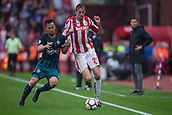 30th September, bet365 Stadium, Stoke-on-Trent, England; EPL Premier League football, Stoke City versus Southampton; Goal scorers Southampton's Maya Yoshida and Stoke City's Peter Crouch fight over the ball