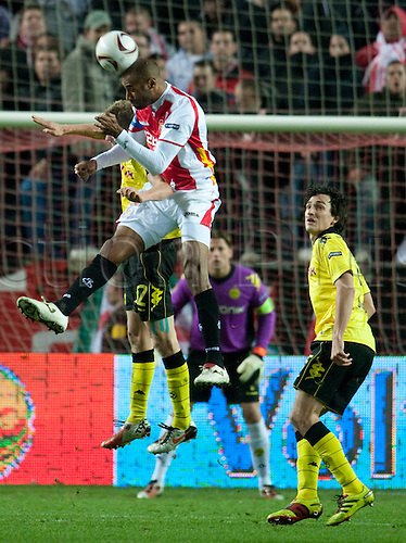Sevilla's Renato (front) and Dortmund's Sven Bender (hidden) fight for the ball during the UEFA Europa League group J match between Sevilla FC and Borussia Dortmund at Stadion Ramon Sanchez Pizjuan in Sevilla, Spain, 15 December 2010. Dortmund's Mats Hummels (R) looks on.