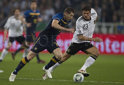 02 03 2011 international match Germany versus Australia.  Australias Bret Emerton against Germany Mario Gomez  Moenchengladbach
