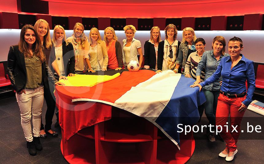 20130814 - EINDHOVEN , NETHERLANDS :  teamcaptains pictured with fltr PSV Eindhoven 's  Danielle Van Den Donk , Heerenveen 's Maruschka Waldus , FC Utrecht 's Helene Heemskerk ,  Telstar 's Lois Oudemast , ADO Den Haag 's Lucienne Reichardt , PEC Zwolle 's Mariska Kogelman , Ajax Amsterdam 's Daphne Koster ,  Lierse 's Caroline Berrens , Standard 's Imke Courtois , R Antwerp FC 's Katrien Van Rooy ,  OH Leuven's Kelly Paulus , AA Gent Ladies ' Elke Van De Sompel and Club Brugge's Christine Saelens (r) during the BENELEAGUE Kick-off Meeting , in the Philips Stadion in Eindhoven prior to season 2013-2014 in the BENE - League competition . Wednesday 14 August 2013. PHOTO DAVID CATRY
