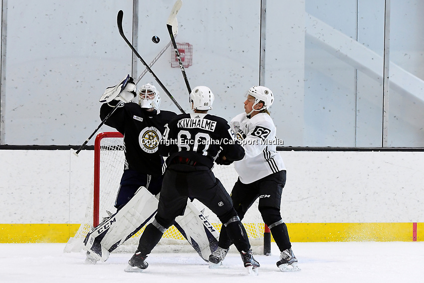 June 28, 2018: Boston Bruins goalie Jeremy Swayman (70) bats at the puck as defenseman Teemu Kivihalme (60) and Boston Bruins forward Oskar Steen (62) spar in front of the net during the Boston Bruins development camp held at Warrior Ice Arena in Brighton Mass. Eric Canha/CSM