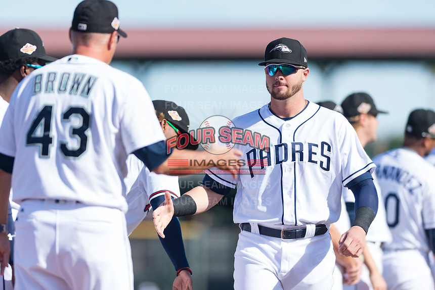Peoria Javelinas catcher Austin Allen (24), of the San Diego Padres organization, shakes hands with manager Daren Brown (43) during player introductions before the Arizona Fall League Championship game against the Salt River Rafters at Scottsdale Stadium on November 17, 2018 in Scottsdale, Arizona. Peoria defeated Salt River 3-2 in 10 innings. (Zachary Lucy/Four Seam Images)