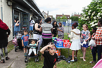 Children and families enjoying the party during Queen Elizabeth II birthday celebrations at the Barking Community Centre in East London.