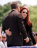 """Gloria Estefan hugs her husband after her performance of """"Always Tomorrow"""" at the 16th Annual National Peace Officers' Memorial Day Service at the U.S. Capitol in Washington, D.C. on May 15, 1997..Credit: Ron Sachs / CNP"""