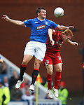 Lee McCulloch muscles his way over teenager Fraser Fyvie