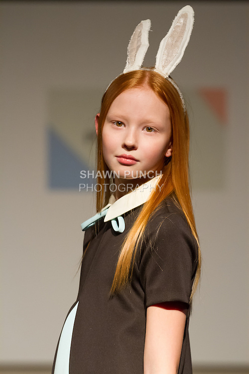 Model walks runway in an outfit by Aisabobo during the petitePARADE Children's Club fashion show at the Jacob Javits Center in New York City, on January 9, 2016.