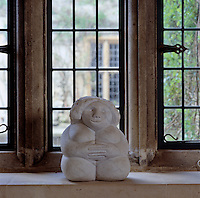 "Rosie Pearson is the patron of an outdoor sculpture exhibition, ""On Form"", which takes place in the garden at Asthall Manor and the house is full of examples of works such as this little figure perched on a living room window sill"