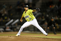 Pitcher Darwin Ramos (34) of the Columbia Fireflies delivers a pitch in a game against the Charleston RiverDogs on Thursday, April 4, 2019, at Segra Park in Columbia, South Carolina. Charleston won, 2-1. (Tom Priddy/Four Seam Images)