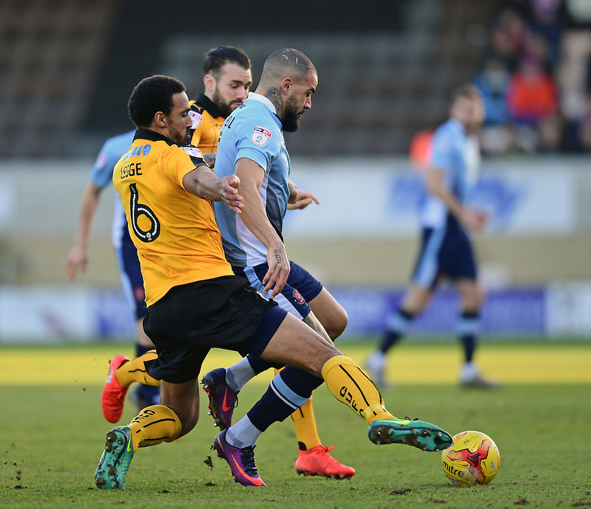 Blackpool's Kyle Vassell shields the ball from Cambridge United's Leon Legge<br /> <br /> Photographer Chris Vaughan/CameraSport<br /> <br /> The EFL Sky Bet League Two - Cambridge United v Blackpool - Saturday 14th January 2017 - The Cambs Glass Stadium - Cambridge<br /> <br /> World Copyright &copy; 2017 CameraSport. All rights reserved. 43 Linden Ave. Countesthorpe. Leicester. England. LE8 5PG - Tel: +44 (0) 116 277 4147 - admin@camerasport.com - www.camerasport.com