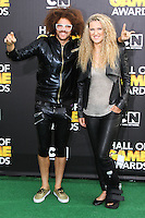SANTA MONICA, CA, USA - FEBRUARY 15: Redfoo, Victoria Azarenka at the 4th Annual Cartoon Network Hall Of Game Awards held at Barker Hangar on February 15, 2014 in Santa Monica, California, United States. (Photo by David Acosta/Celebrity Monitor)