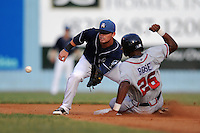 Asheville Tourists second baseman Brett Tanos #9 awaits the ball to apply the tag on a sliding Kyle Rose during a game against the Rome Braves at McCormick Field on August 20, 2011 in Asheville, North Carolina. Rome won the game 10-9.   (Tony Farlow/Four Seam Images)