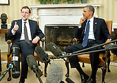 Mariano Rajoy Brey, President of the Government of the Kingdom of Spain (Prime Minister), left, answers a reporter's question as United States President Barack Obama looks on in the Oval Office of the White House in Washington, D.C. on Monday, January 13, 2014.<br /> Credit: Ron Sachs / Pool via CNP