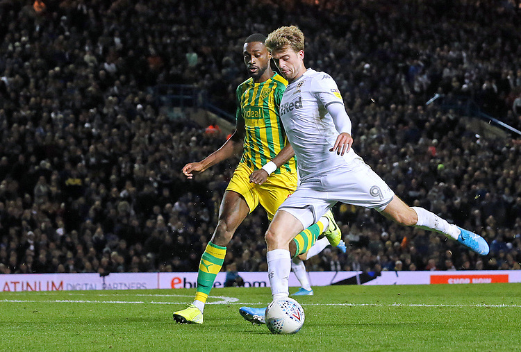 Leeds United's Patrick Bamford sets up to shoot from close range despite the attentions of West Bromwich Albion's Semi Ajayi<br /> <br /> Photographer Rich Linley/CameraSport<br /> <br /> The EFL Sky Bet Championship - Tuesday 1st October 2019  - Leeds United v West Bromwich Albion - Elland Road - Leeds<br /> <br /> World Copyright © 2019 CameraSport. All rights reserved. 43 Linden Ave. Countesthorpe. Leicester. England. LE8 5PG - Tel: +44 (0) 116 277 4147 - admin@camerasport.com - www.camerasport.com