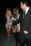 .March 24th 2012 ...Ashley Tisdale & friend at Perez Hiltons party in Hollywood California wearing blue suede shoes red bow tie ribbon tan legs American flag shirt short dazy dukes jean shorts..AbilityFilms@yahoo.com.805-427-3519.www.AbilityFilms.com.