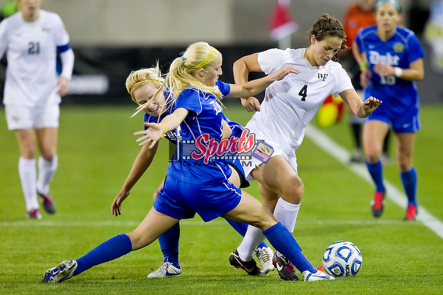 Rachel Nuzzolese #4 of the Wake Forest Demon Deacons tries to keep the ball away from Erin Koballa #14 and Libby Jandl #3 of the Duke Blue Devils in the semifinals of the 2011 NCAA Women's College Cup at Kennesaw State Soccer Stadium on December 2, 2011 in Kennesaw, Georgia.  The Blue Devils defeated the Demon Deacons 4-1 to advance to the Women's College Cup Championship.    (Brian Westerholt / Sports On Film)