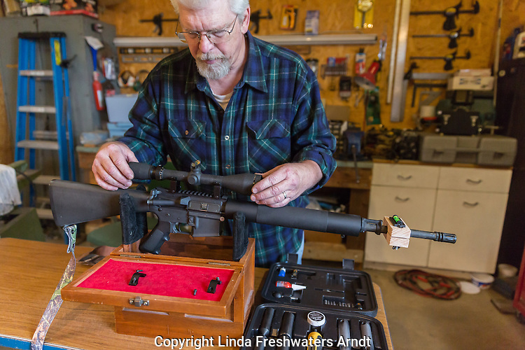Man mounting a scope to an AR-15