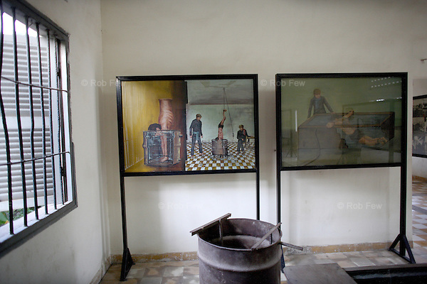 One of the survivors was Vann Nath, who was kept alive by the regime to paint pictures of Pol Pot. After his release, he painted pictures of the tortures he witnessed while at S-21, such as these. In the foreground is one of the barrels shown in Vann Nath's painting.<br /> <br /> On 17th April 1975, after five years of civil war, Cambodia's capital Phnom Penh fell to the Khmer Rouge, who instigated a brutal reign of terror that would see the death of some 1.7 million Cambodians. In an attempt to create a self-sufficient agrarian paradise, cities were emptied, money and religion were banned and roughly a quarter of the population was worked and starved to death or executed. <br /> <br /> At the centre of this brutality was S-21, also known as Tuol Sleng, the Khmer Rouge prison located in the grounds of an old Phnom Penh school. Before the Vietnamese liberation of Phnom Penh on 7th January 1979, at least 14,000 people were tortured and executed here or at the nearby Choeung Ek killing field.