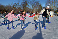 STAFF PHOTO BEN GOFF  @NWABenGoff -- 12/28/14 Mark Deihl pulls his daughter Brook Deihl, 11, and her friends Adelia Perez, 12, and Alyssa Brassfield, 10, while visiting The Rink at Lawrence Plaza in Bentonville on Sunday Dec. 28, 2014.